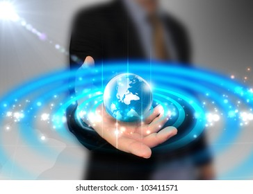 businessman holding globe glowing