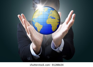 Businessman holding globe in hand :Data source: NASA