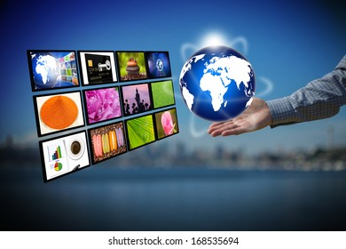 Businessman holding globe with internet production technology concept