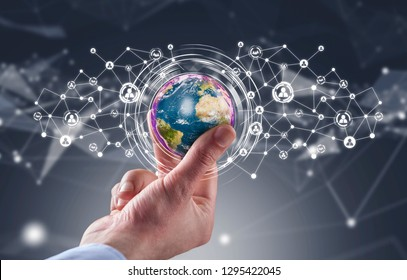 Businessman holding globe with social media network icons structure