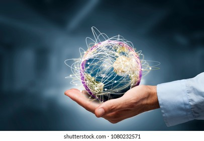 Businessman holding globe,Internet Concept of global business.Elements of this image furnished by NASA