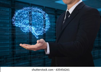 businessman holding glow abstract brain structure with server room background