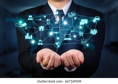 businessman holding glow icon concept of Internet Of Things