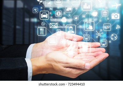 businessman holding glow internet of things icon