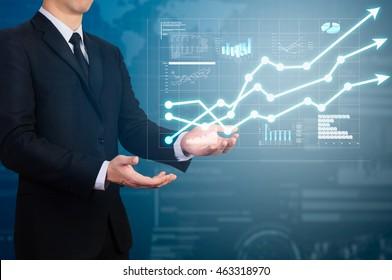 businessman holding glow uptrend chart