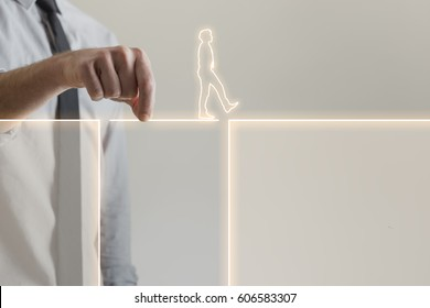 Businessman holding glowing bridge passage line to help outlined image of man walk across the gap, business assistance concept.