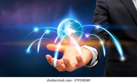 Businessman holding glowing globe. Business connection concept.