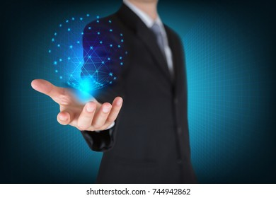 Businessman holding the glowing hologram digital globe as business, innovation, intelligent, idea and globalization concept