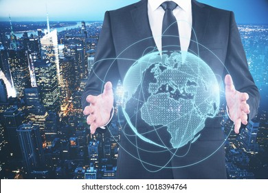 Businessman holding glowing planet on blue background. Global business concept. Double exposure