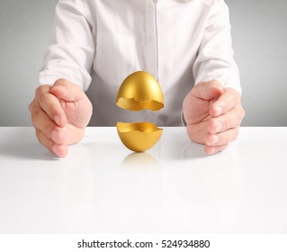 Businessman Holding Of Golden Eggs