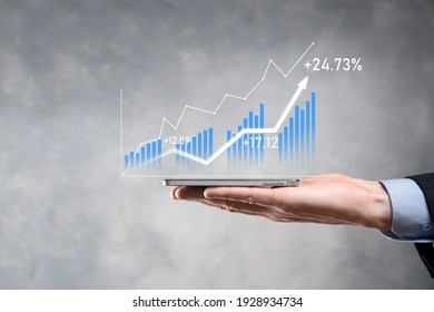 Businessman holding graph growth and increase of chart positive indicators in his business.Investment up concept.analyzing sales data and economic,strategy and planning, Digital marketing and stock