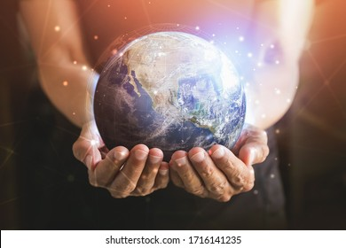 Businessman holding in hands with global connection concept. Energy saving concept, Elements of this image furnished by NASA