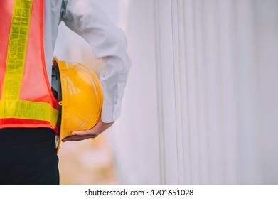 Businessman holding hard hat building estate construction project
