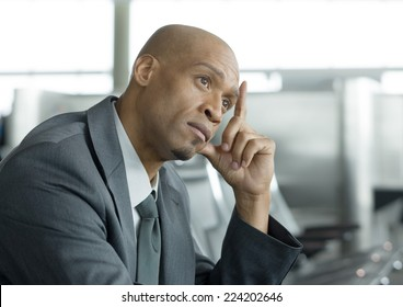 Businessman holding head and thinking