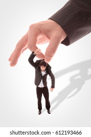 Businessman holding his puppet in his hand