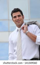 Businessman holding his suit jacket over his shoulder