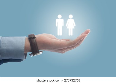 Businessman holding human resources on his hand