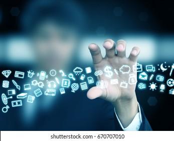 businessman holding icons