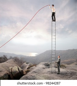 Businessman holding a ladder on which another businessman stands and charts a positive trend graph
