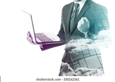 Businessman holding a laptop and forming a fist isolated on white