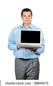 Businessman holding a laptop isolated on white
