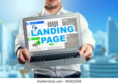 Businessman holding a laptop with an landing page. Business, technology, internet and networking concept.