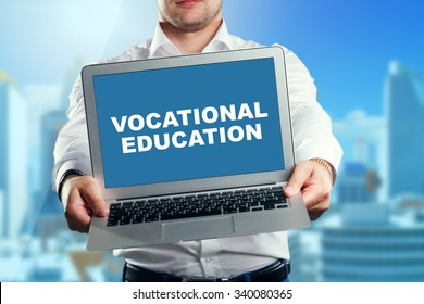 Businessman holding a laptop with an vocational education. Business, technology, internet and networking concept.