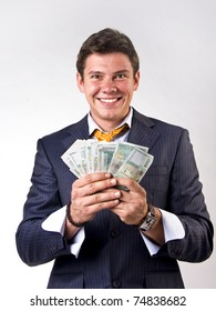 Businessman holding lots of money in his hands