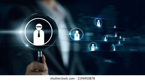 Businessman holding magnifying glass, searching for good and quality employees. officer looking for employee represented by icon. Recruitment, CRM, human resource, HR, teamwork concept.