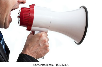 Businessman holding megaphone and shouting, isolated