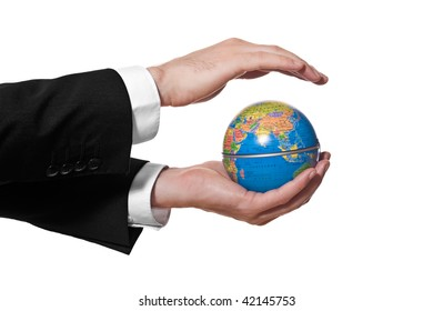 businessman holding a mini globe on white background