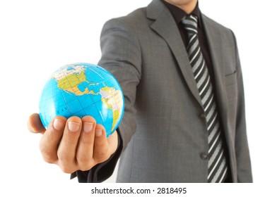 businessman holding mini globe, shallow dof