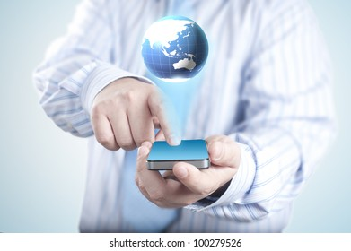 Businessman holding mobile phone with 3D Globe. Concept for connectivity, internet, and communication