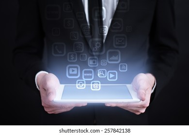 businessman holding a mobile phone with applications icons on the screen.  internet concept. business concept.