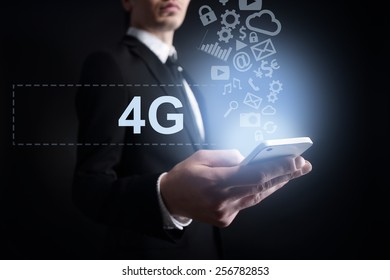 businessman holding a mobile phone with cloud computing text and applications icons. Internet concept.