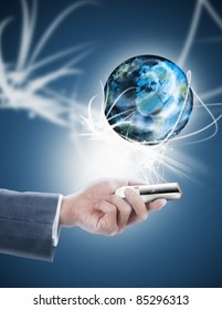 businessman holding mobile phone with globe
