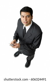 Businessman, holding mobile phone, looking at camera