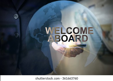 Businessman holding mobile phone with WELCOME ABOARD  text on virtual screen. Internet concept.