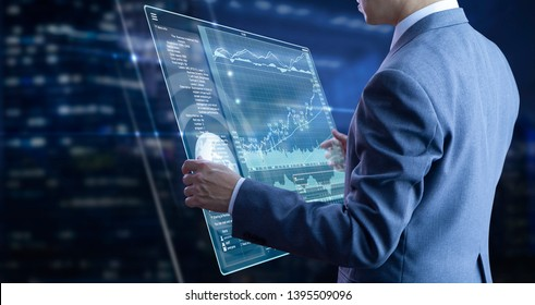 Businessman holding a modern tablet touch screen analysing on investment risk managment and return on investment analysis