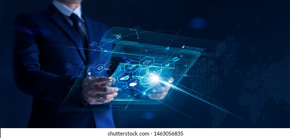 Businessman holding modern virtual interface banking in hand with icon network connection, shopping and mobile payment online on dark background