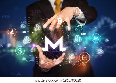 Businessman holding monero symbol, investment concept