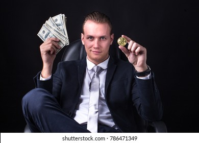 Businessman holding money and bitcoin with smiling. Business man with business success concept. Isolated on black blackground.