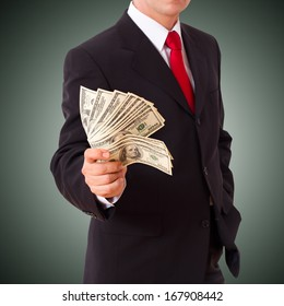 Businessman holding Money Cash Dollars in  hands of passing them to the client. Concept of finance success. Isolated, space for text