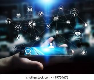 Businessman holding multimedia network over mobile phone 3D rendering