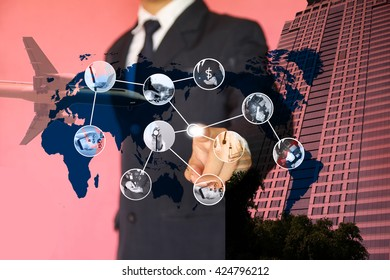 businessman holding notebook with social icons