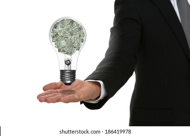 Businessman holding out arm with a money lightbulb floating above hand