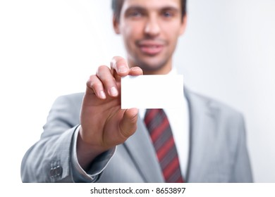 businessman holding out a blank business card