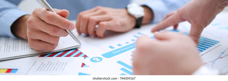 Businessman holding pan in hand financial statistics documents infographics office table closeup. Internal  inspector sum check, investigation exchange market earnings savings loan and credit concept