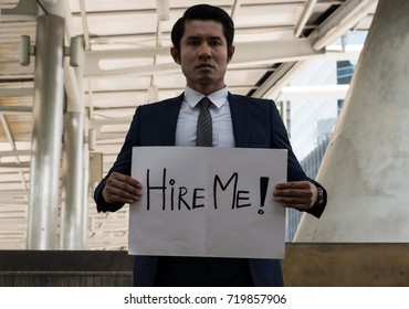 Businessman holding paper with hire me text message