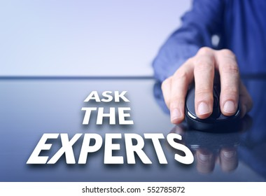 """Businessman holding a PC mouse with """"Ask the experts"""" text on the virtual screen. Internet concept. Business concept."""